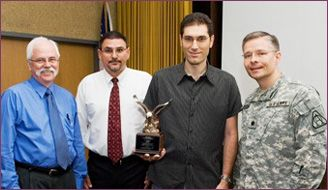 From Left, Jack McClafferty, Arrowhead Program Director; Ray Rampi, Apache Fire Control Procurement Manager; Itai Vishnia, Chief Operating Officer PLX Inc.; Lt. Colonel Scott Bosse, Program Manager Apache Sensors.
